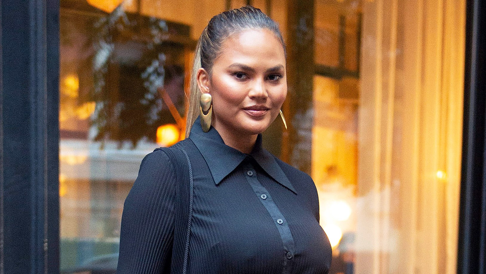 Chrissy Teigen Responds After Critics Slam Her for Mixing Kimchi With Her Hands: 'Using My feet Next Time'