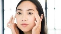 woman massaging face