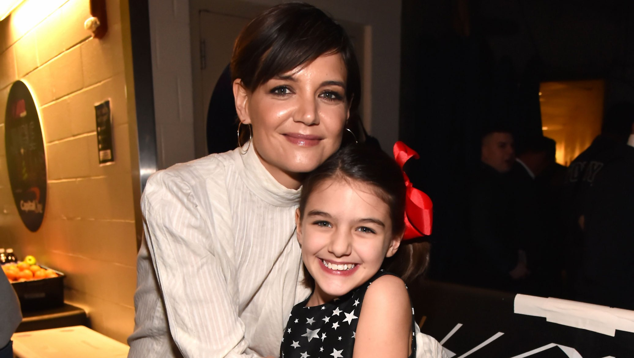 Suri Cruise Looks Just Like Dad Tom Cruise on Visit to Refugee Camp With Mom Katie Holmes: Photos
