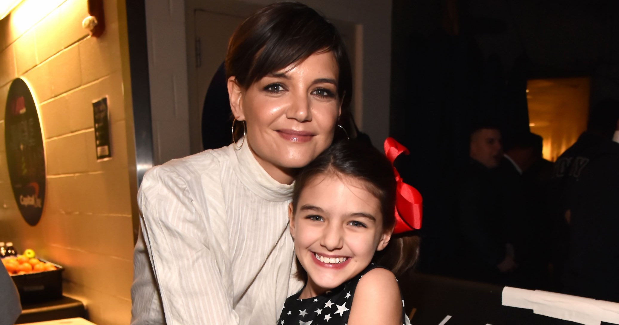 Suri Cruise Looks Like Dad Tom on Visit to Refugee Camp With Katie Holmes