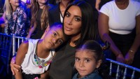 Kim Kardashian cuddles daughter North West and niece Penelope Disick