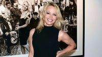 Pamela Anderson Wearing A Black Dress and Black High Heels In A Art Gallery