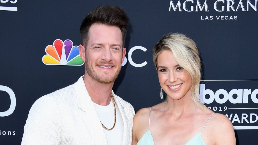 Tyler Hubbard Wearing A White Suit and Hayley Stommel Hubbard Pregnant Wearing A Blue Dress