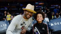 Taye Diggs and His Son Walker Diggs Watch Basketball Game Lakers vs Pacers Large Brim Hat and Glasses