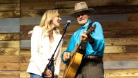 Inside the Denver Wellness Your Way Festival Jewel and her father, Atz Kilcher, performing together on the Johnson & Johnson main stage