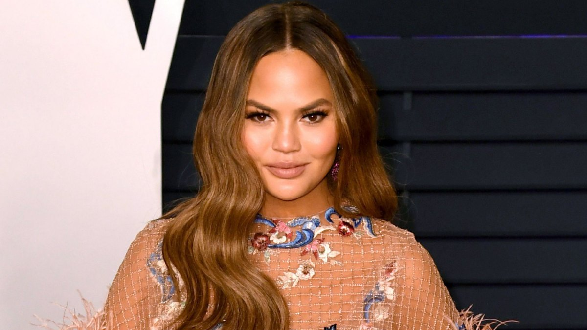 Chrissy Teigen Claps Back at Troll Who Tells Her to 'Cover Up' Her Breasts Around Her Daughter