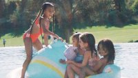 North West Chicago West Penelope Disick and Saint West on a Pool Float