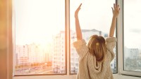 woman-stretching-sunrise-zinc