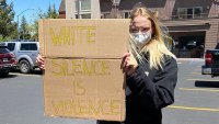 Sophie Turner supporting Black Lives Matter with a Sign that Says White Silence is Violence