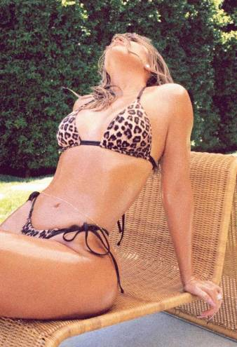 Khloe Kardashian Heats Things Up in a Sexy Leopard Print Swimsuit