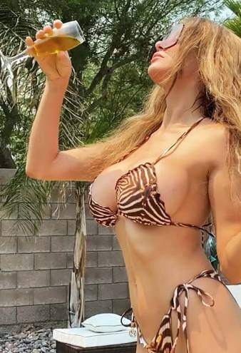 Courtney Stodden Pours Champagne All Over Herself in Teeny Bikini