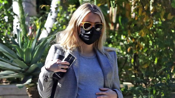 See Pregnant Emma Roberts Cradling Baby Bump While House Hunting
