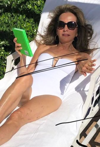 Susan Lucci, 74, Sizzles in Sexy White One-Piece