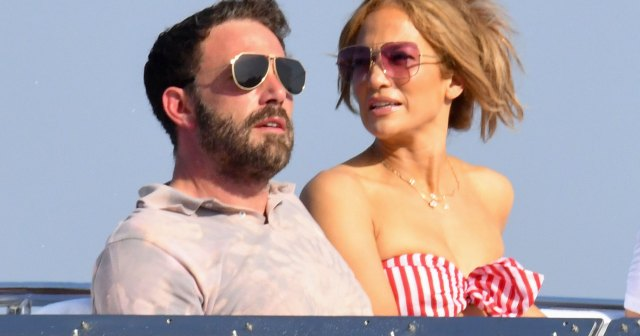 Jennifer Lopez Sits on Ben Affleck's Lap at Dinner as Their European Vacation Continues.jpg