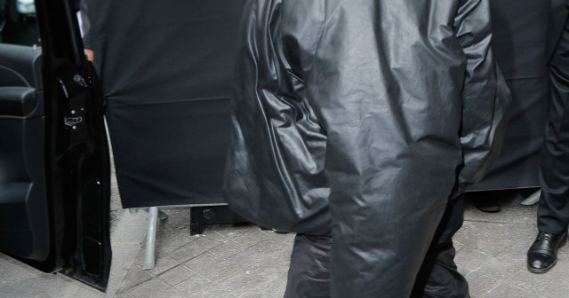 Kanye West Attends Balenciaga Fashion Show in Full Face Covering, Yeezy x Gap Coat.jpg