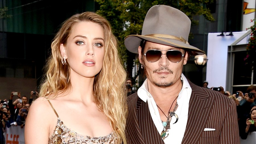 """Amber Heard and Johnny Depp attend """"The Danish Girl"""" premiere during the 2015 Toronto International Film Festival."""