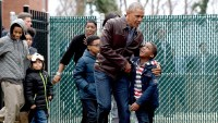 "President Barack Obama talks with kids as he visits with them as they play on the ""Malia and Sasha's Castle,"" the playground that the Obamas donated to the Jobs Have Priority Naylor Road Family Shelter in Washington, Monday, Jan. 16, 2017."
