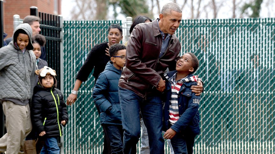 """President Barack Obama talks with kids as he visits with them as they play on the """"Malia and Sasha's Castle,"""" the playground that the Obamas donated to the Jobs Have Priority Naylor Road Family Shelter in Washington, Monday, Jan. 16, 2017."""