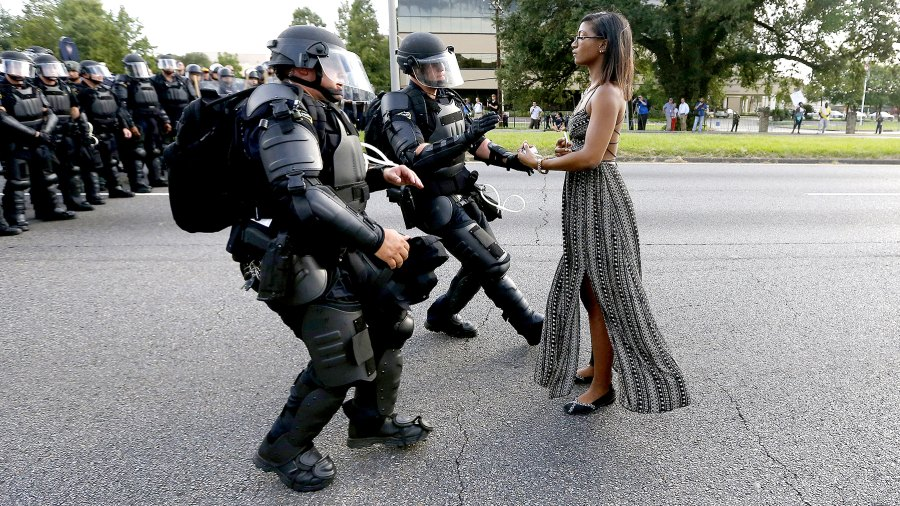 A demonstrator protesting the shooting death of Alton Sterling is detained by law enforcement near the headquarters of the Baton Rouge Police Department in Baton Rouge, Louisiana, U.S. July 9, 2016.
