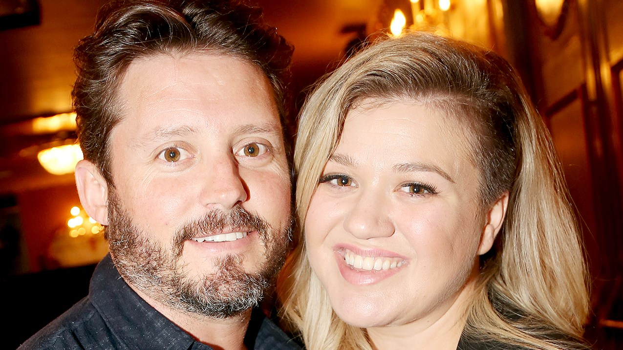 """Brandon Blackstock and Kelly Clarkson pose backstage at the hit musical """"Finding Neverland"""" on Broadway at The Lunt Fontanne Theater on July 15, 2015 in New York City."""