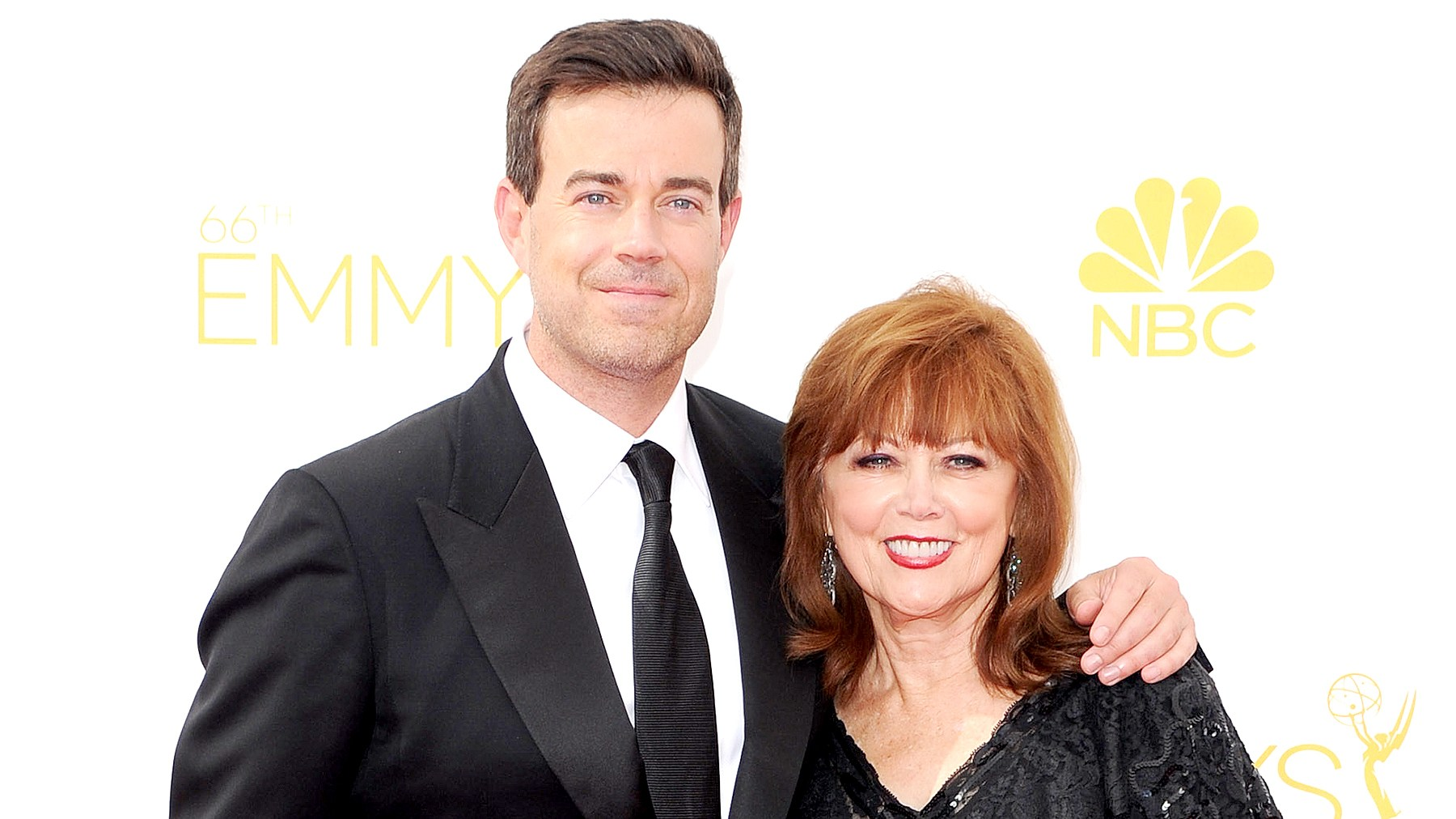 Carson Daly and Pattie Daly Caruso arrive at the 66th Annual Primetime Emmy Awards at Nokia Theatre L.A. Live on August 25, 2014 in Los Angeles, California.