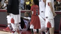 Chris Brown sits during the national anthem