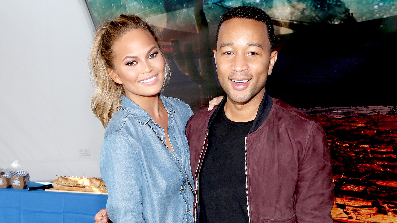 Chrissy Teigen and John Legend attend the DIRECTV Super Fan Tailgate at Pendergast Family Farm on February 1, 2015 in Glendale, Arizona.