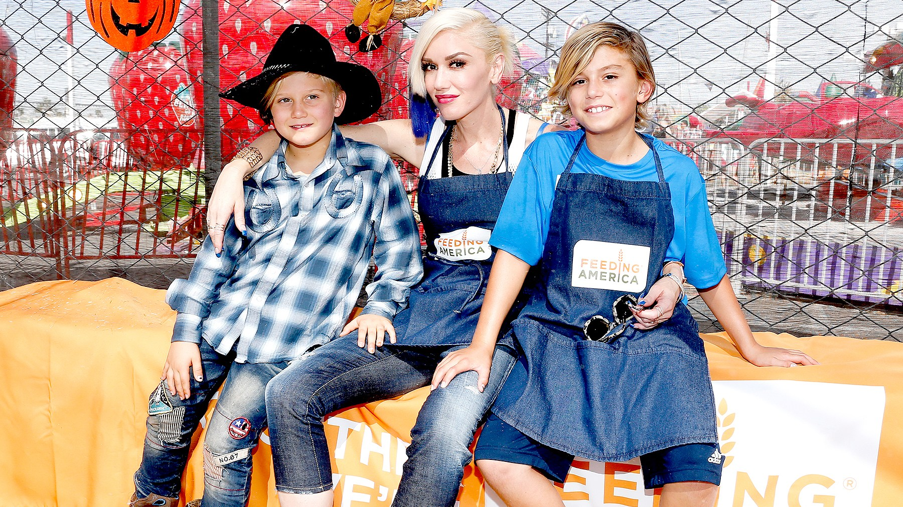 Zuma Rossdale, Gwen Stefani and Kingston Rossdale volunteer at the Feeding America Holiday Harvest event at Shawn's Pumpkin Patch in partnership with the LA Regional Food Bank, supported by Bank of America Charitable Foundation on October 24, 2015 in Culver City, California.