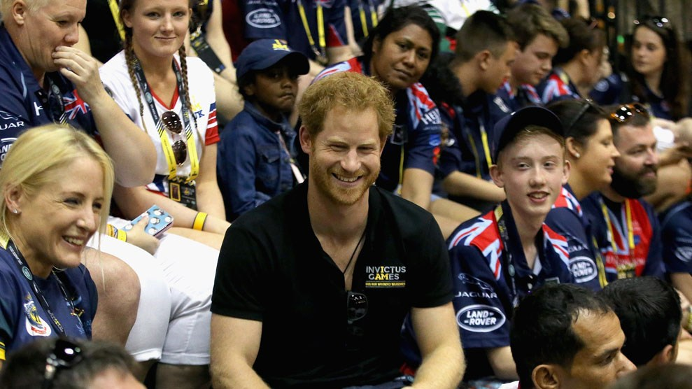 Prince Harry sits in the crowd watching sitting volleyball in Orlando, Florida