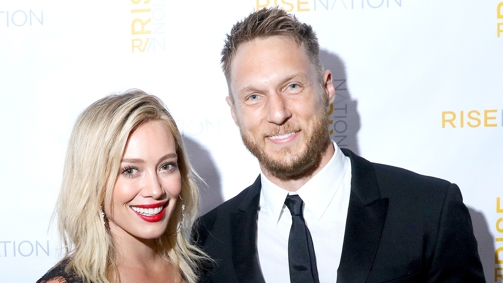 Hilary Duff and Jason Walsh attend 'Rise Nation Fitness Studio's Los Angeles Grand Opening' on August 21, 2015 in West Hollywood, California.