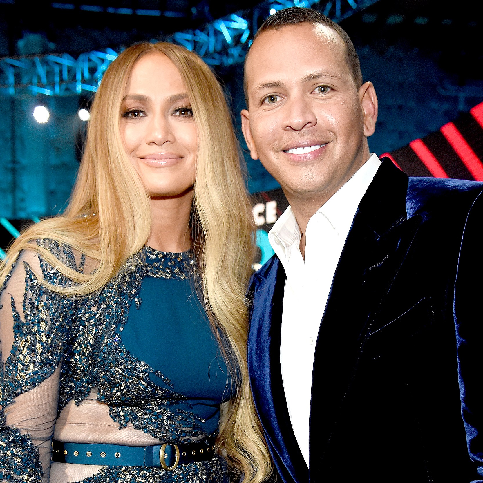 "Jennifer Lopez and Alex Rodriguez pose onstage during ""One Voice: Somos Live! A Concert For Disaster Relief"" at the Universal Studios Lot on October 14, 2017 in Los Angeles, California."