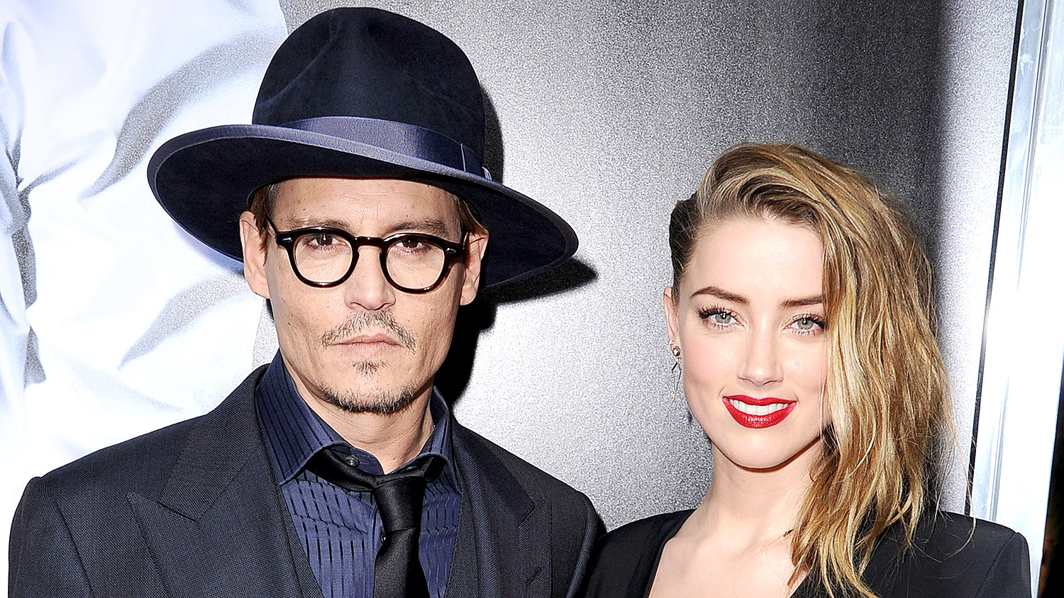"""Johnny Depp and Amber Heard arrives at the """"3 Days To Kill"""" at ArcLight Cinemas on February 12, 2014 in Hollywood, California."""