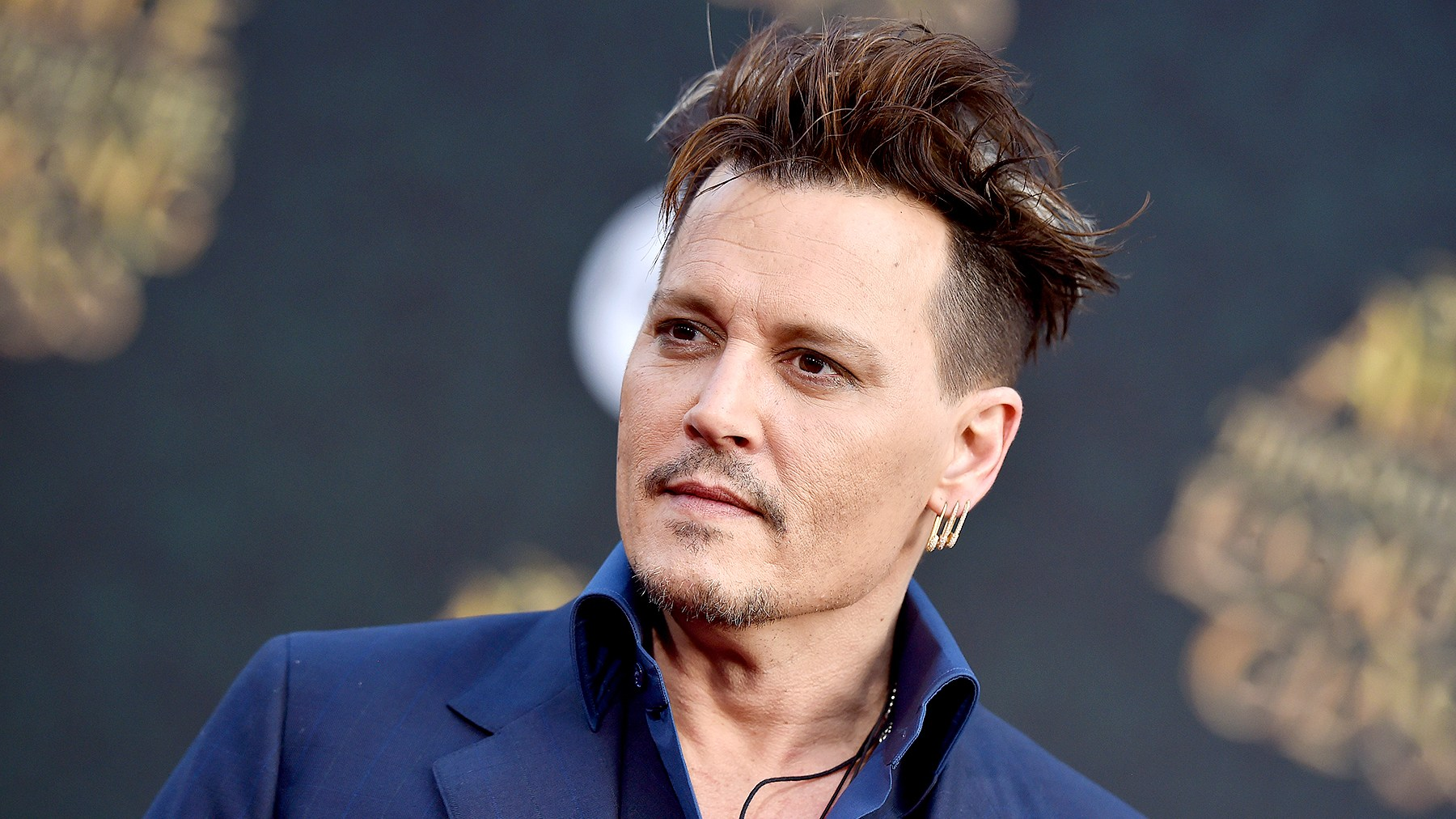 Johnny Depp arrives at the premiere of Disney's 'Alice Through The Looking Glass' at the El Capitan Theatre on May 23, 2016 in Hollywood, California.
