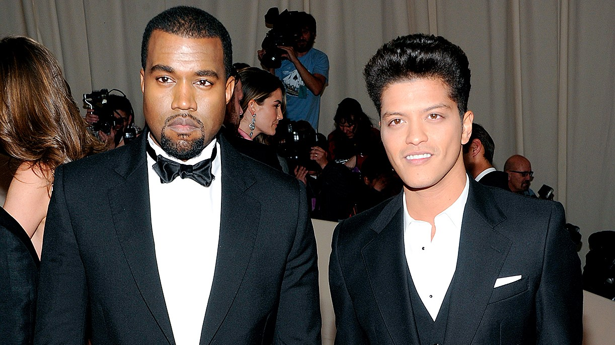 Kanye West, left, and Bruno Mars arrive at the Metropolitan Museum of Art Costume Institute gala benefit, celebrating the 'Alexander McQueen: Savage Beauty' exhibition, Monday, May 2, 2011 in New York.