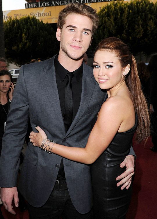 Miley Cyrus & Liam Hemsworth at an event