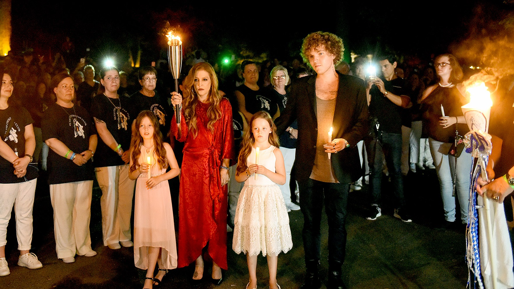 On the 40th anniversary of his passing, Harper Lockwood, Lisa Marie Presley, Finley Lockwood, and Ben Keough joined over 50 thousand people for the candlelight vigil at Graceland, in honor of Elvis.