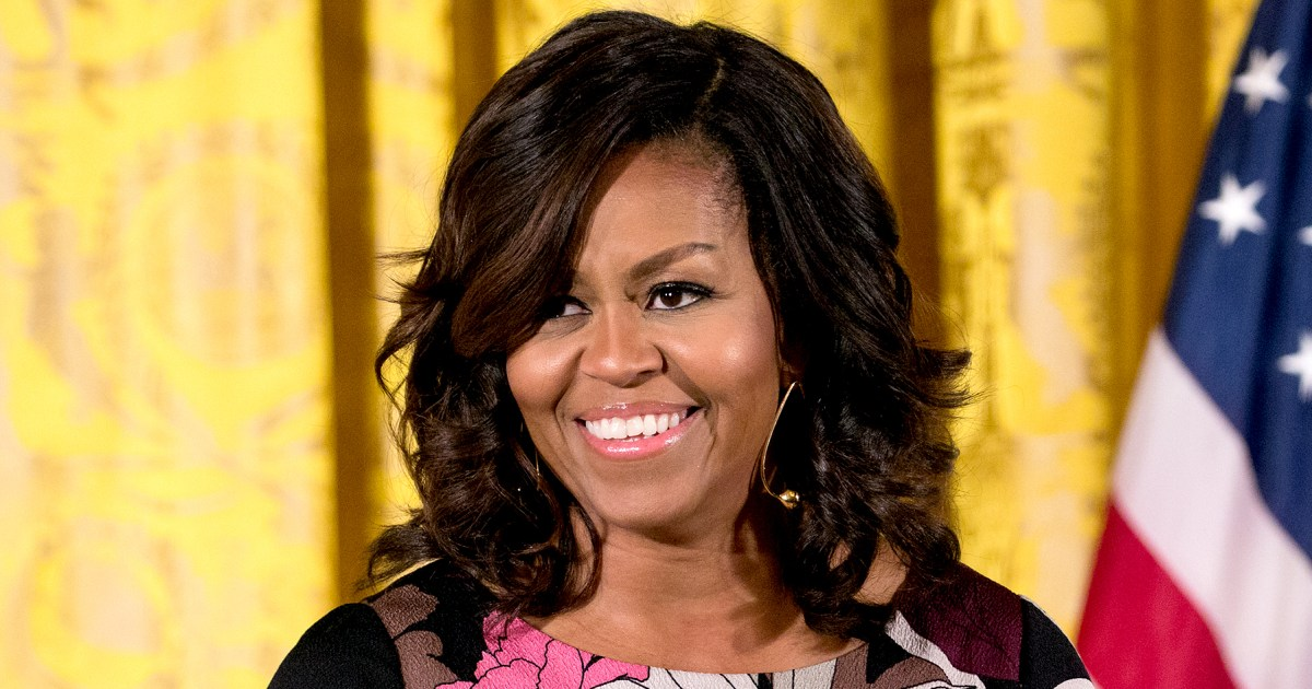 Michelle obama debuts new hairstyle pics pmusecretfo Images