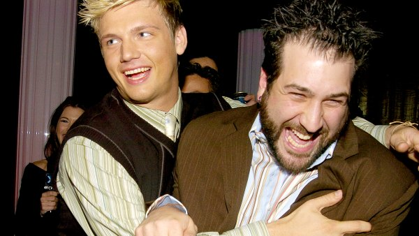 Nick Carter pushes Joey Fatone out of a Backstreet Boys interview in Backstage Creations Talent Retreat at Motown 45 Special in 2004.