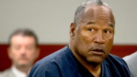 O.J. Simpson listens as his defense attorney, Ozzie Fumo, questions witness David Cook during an evidentiary hearing in Clark County District Court May 16, 2013 in Las Vegas, Nevada. Julie Jacobson-Pool/Getty Images