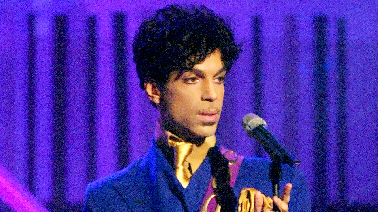 "Prince performs the song ""Purple Rain"" at the 46th Annual Grammy Awards."