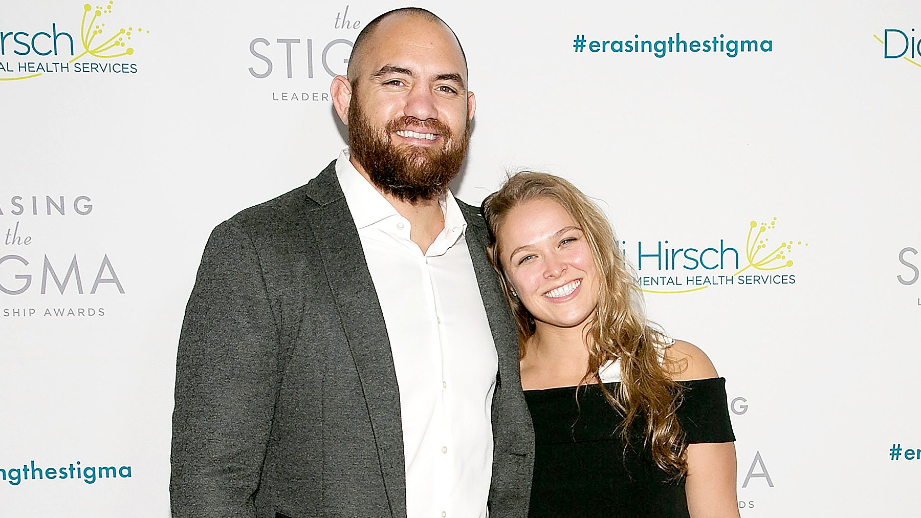 Travis Browne and Ronda Rousey arrive for the 20th Anniversary Erasing The Stigma Leadership Awards at The Beverly Hilton Hotel on April 28, 2016 in Beverly Hills, California.