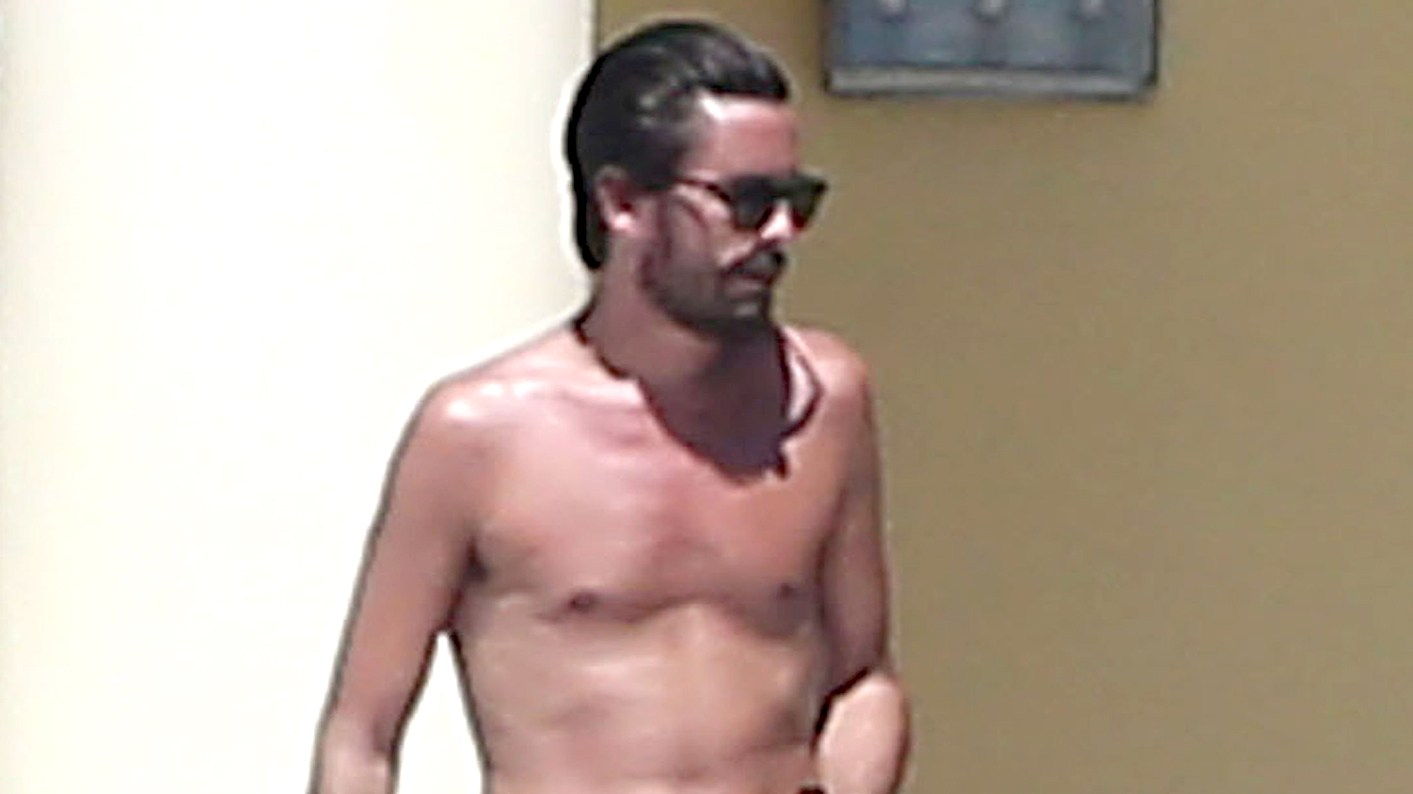 Scott Disick is seen drinking and partying with a group of females while on vacation with 'Girls Gone Wild' founder Joe Francis and his girlfriend Abbey Wilson in Mexico on March 2, 2016.