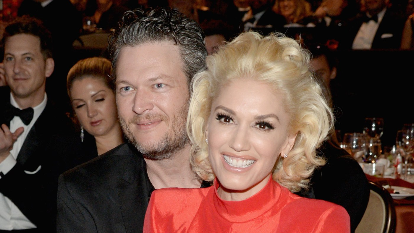 Gwen Stefani and Blake Shelton cuddle up at Clive Davis' pre-Grammys 2016 party