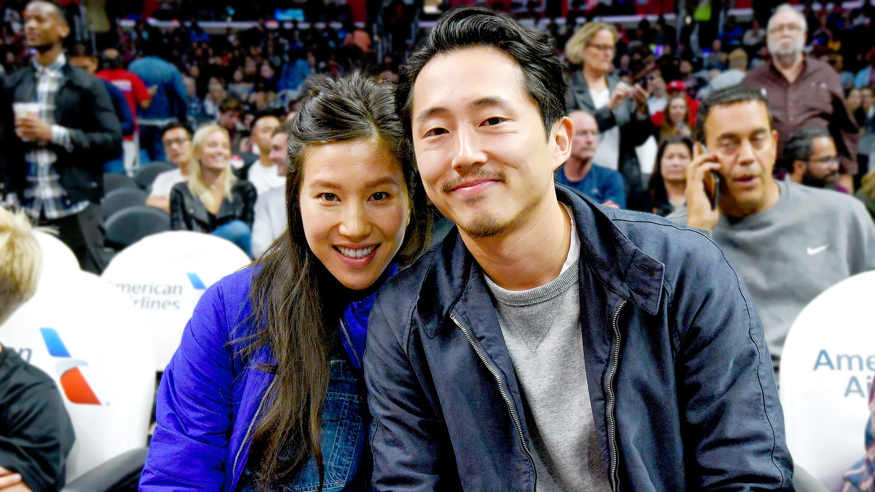 Steven Yeun (R) and Joana Pak attend a basketball game between the Detroit Pistons and the Los Angeles Clippers at Staples Center on November 7, 2016 in Los Angeles, California.