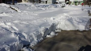 view from driveway of snowbound street
