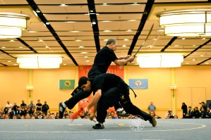 Fellow disciples Shi Fu Paul Jakubowki and advanced degree Black Sash performed double broadsword vs. spear at the US Interenational Kuo Shu Championship Tournament Opening Ceremonies.