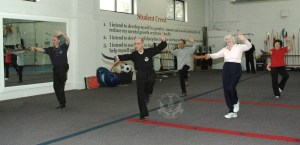 Broadsword form in the Adult Tai Chi class at U.S. Martial Arts Academy, Ltd. Timonium Maryland U.S.A.©2015 Maricar Jakubowski All rights reserved. No usage allowed in any form without the written consent of the photographer.