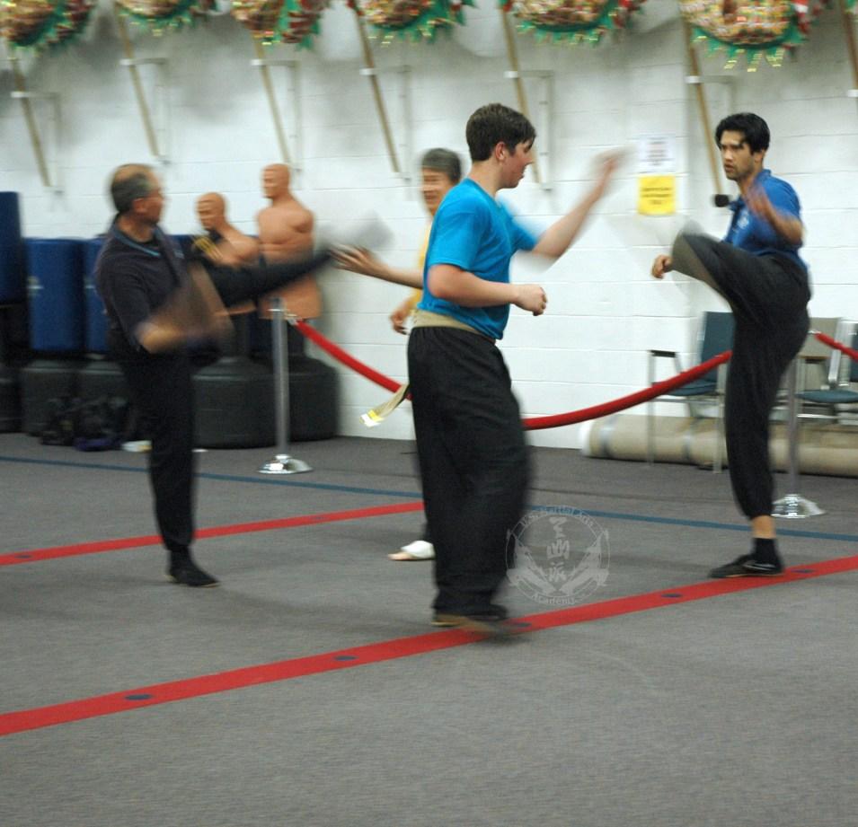 Blocking kicks practice in Adult Kung Fu class at U.S. Martial Arts Academy, Ltd. Timonium Maryland U.S.A.©2015 Maricar Jakubowski www.usmaltd.com 410-561-9882 All rights reserved.