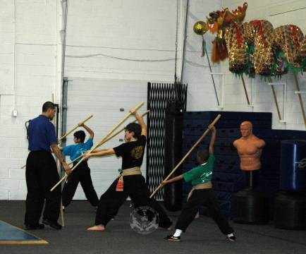 Kung Fu class of upper belts/sashes working with long staff and spear at US Martial Arts Academy, Ltd in Timonium, Maryland, 21093 www.usmaltd.com, 410-561-9882. ©2015 Maricar Jakubowski All rights reserved. No usage allowed in any form without the written consent of the photographer.