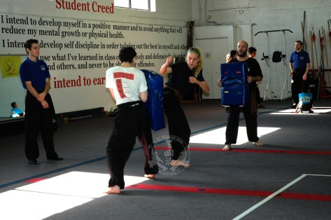 Kicking Drill in Family Kung Fu Class at US Martial Arts Academy, Ltd in Timonium, Maryland, www.usmaltd.com, 410-561-9882. ©2015 Maricar Jakubowski All rights reserved. No usage allowed in any form without the written consent of the photographer.